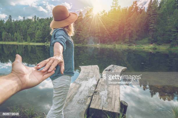 Follow me to nature, girlfriend leading man to lake