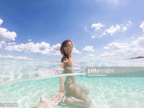follow me to paradise, underwater shot - following stock pictures, royalty-free photos & images