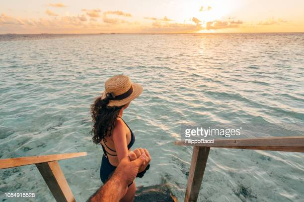follow me to the sea at sunset - indian ocean stock pictures, royalty-free photos & images
