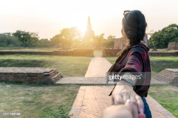 follow me to the temple, ayuthaya, thailand. - girlfriend stock pictures, royalty-free photos & images