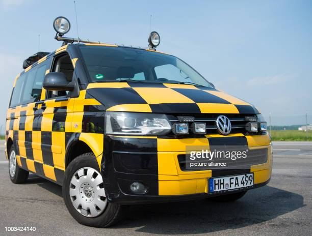 A 'follow me' vehicle parked in the grounds of the airport in Hamburg Germany 30 May 2017 Hamburg Airport has expanded and renovated the building for...