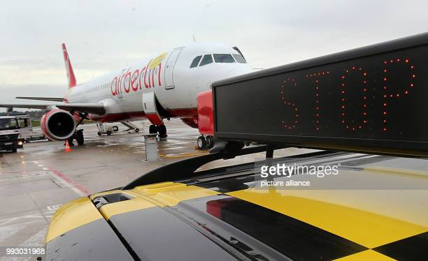 A 'Follow Me' vehicle parked next to an airplane of the bankrupt airline Air berlin at BerlinTegel Airport in Berlin Germany 02 November 2017 Photo...