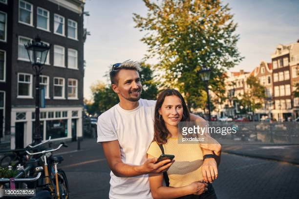 follow the way of love - amsterdam stock pictures, royalty-free photos & images