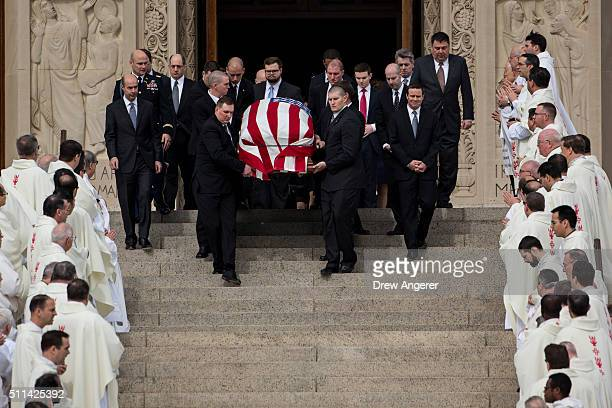 Followed by family members pallbearers carry the casket of late Supreme Court justice Antonin Scalia down the steps of the Basilica of the National...