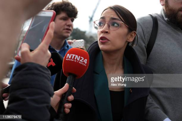 Followed by members of the media US Rep Alexandria OcasioCortez leaves a news conference at the East Front of the US Capitol February 7 2019 in...