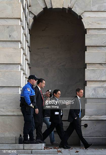Followed by reporters US Secretary of Treasury Timothy Geithner leaves the Capitol after meetings with congressional leaders November 29 2012 on...