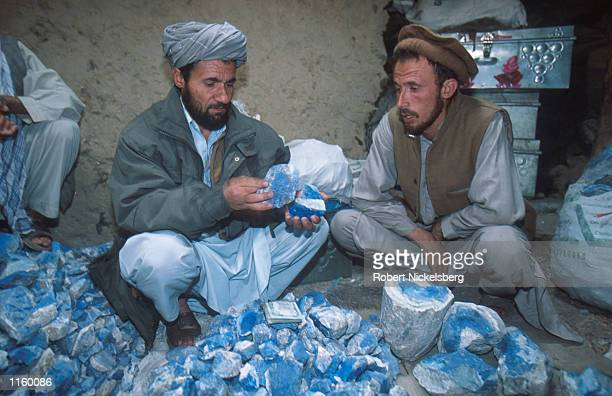 A follower of Afghani opposition leader General Ahmed Shah Massoud displays pieces of lapis lazuli at a Massoud stronghold May 2001 in the Panjshir...