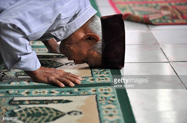 A follower of the Ahmadiyah Muslim sect prays at a mosque in Jakarta on June 10 2008 Liberal Indonesians accused the government of caving in to...