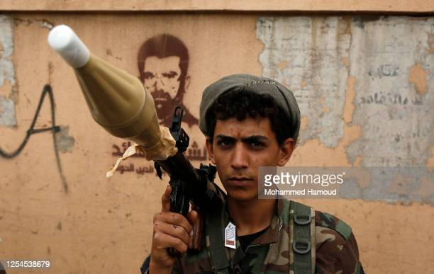 Follower of the Houthis group holds a bazooka during a tribal gathering against the Saudi-led coalition war on Yemen on July 06, 2020 in Sana'a,...