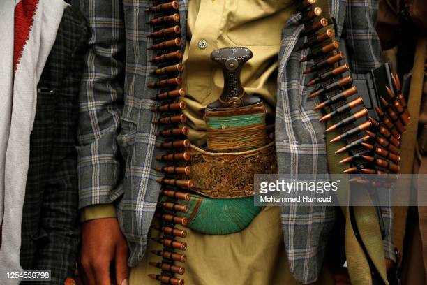 Follower of the Houthis group with gun bullets belt takes part in a tribal gathering against the Saudi-led coalition war on Yemen on July 06, 2020 in...