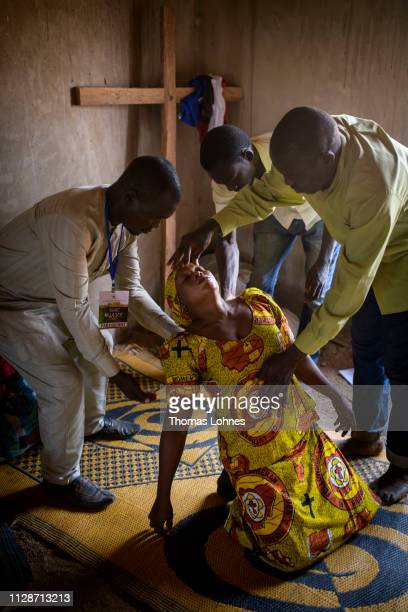 Followers of a religious group called the Lutheran Intercessors pray for the healing of a woman at the 2019 Annual National Convention of the...