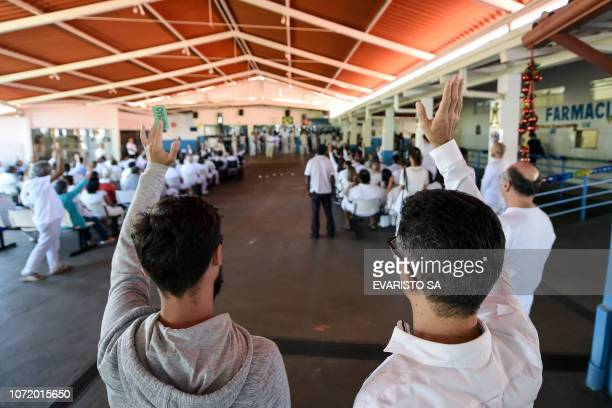 Followers of Brazilian 'spiritual healer' Joao Teixeira de Faria known as 'Joao de Deus' pray at his 'healing center' Casa de Dom Inacio de Loyola in...