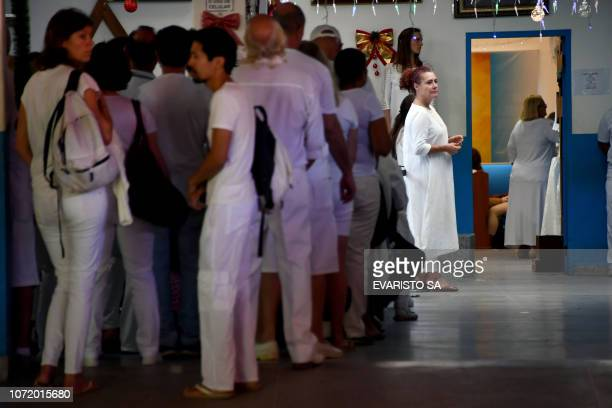 Followers of Brazilian 'spiritual healer' Joao Teixeira de Faria known as 'Joao de Deus' wait for their turn to be attended at Faria's 'healing...