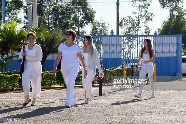 Followers of Brazilian 'spiritual healer' Joao Teixeira de Faria known as 'Joao de Deus' arrive at his 'healing center' Casa de Dom Inacio de Loyola...