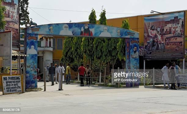 Followers of controversial Indian guru Ram Rahim Singh are seen at the entrance of the 'Dera Sacha Sauda' ashram in Sirsa on August 27 2017...