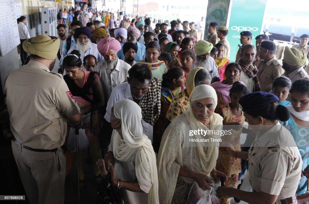 Followers of Dera Sacha Sauda arrive for the support of Dera Chief Sant Gurmeet Ram Rahim Singh as the hearing of Sadhavi rape and murder case will...