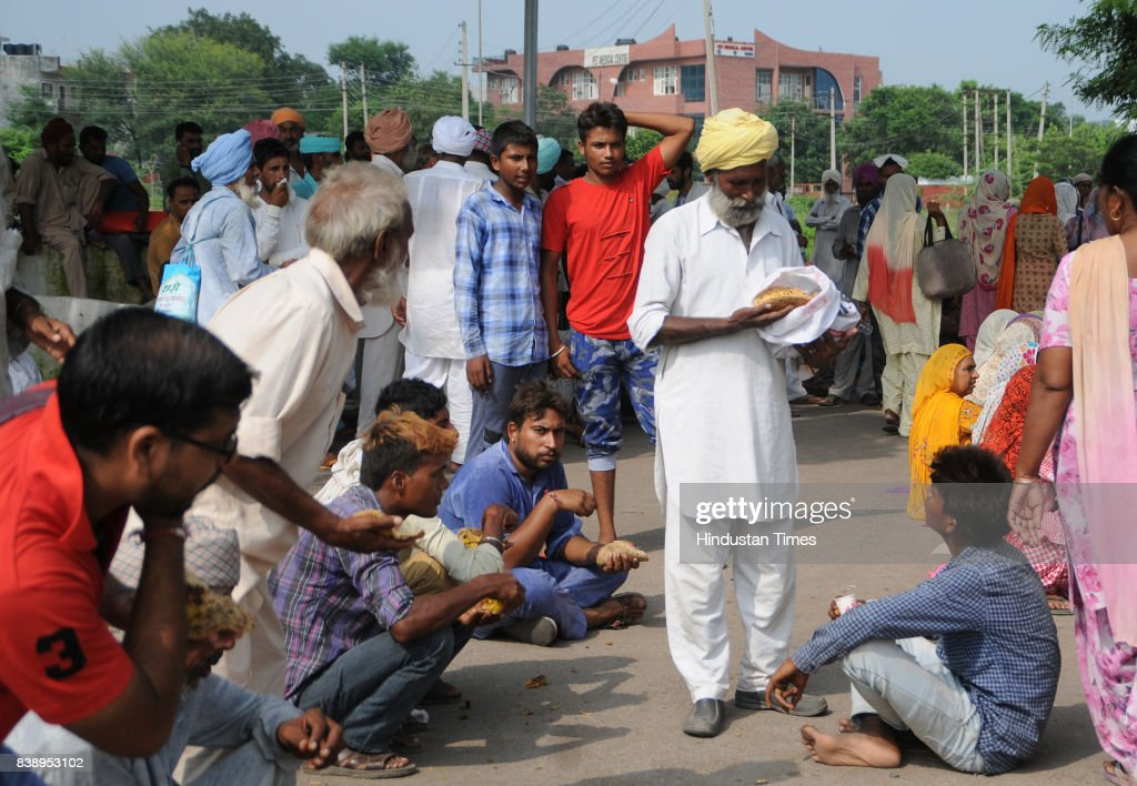 Followers of Dera Sacha Sauda at a park sector 3 on August 24 2017 in Panchkula India The godman was charged with rape of a female devotee in 1999...