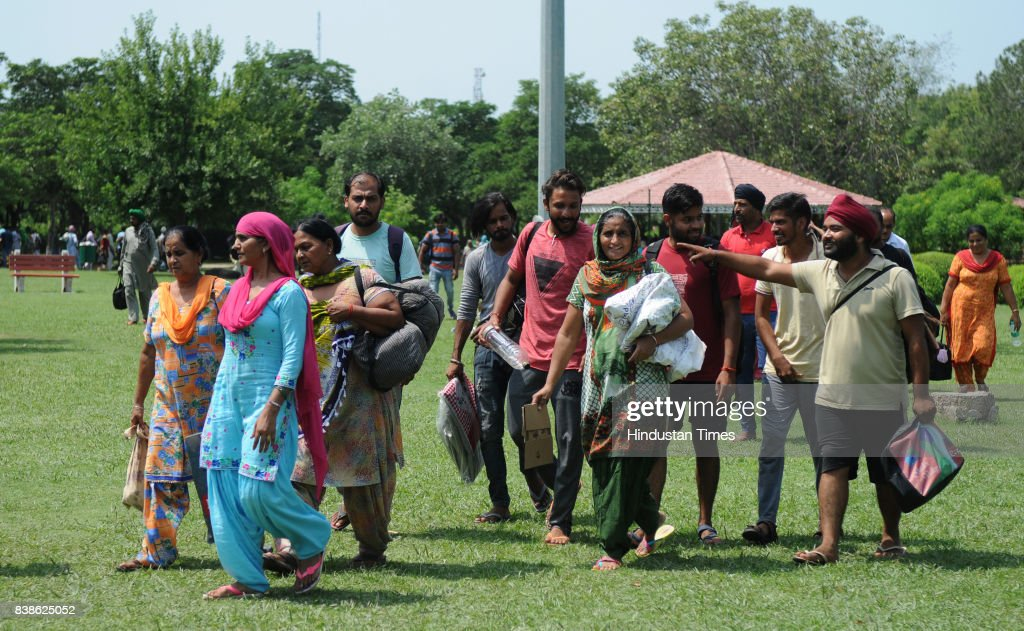 Followers of Dera Sacha Sauda at a park sector 5 on August 24 2017 in Panchkula India The godman was charged with rape of a female devotee in 1999...