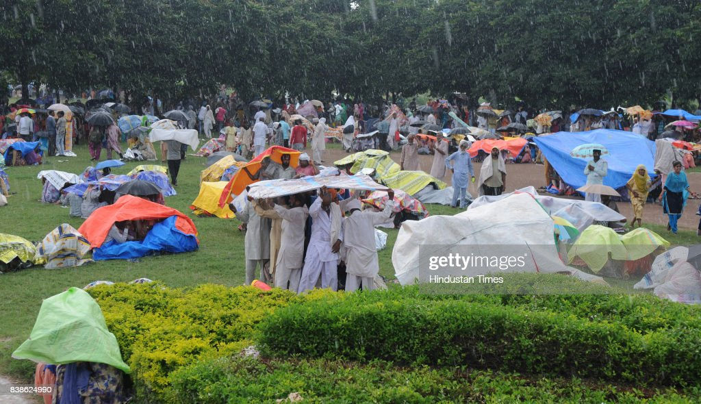 Followers of Dera Sacha Sauda during rain at sector 3 on August 24 2017 in Panchkula India The godman was charged with rape of a female devotee in...