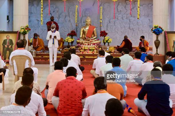 Followers of Dr B.R. Ambedkar, the chief architect of the Indian constitution, gather during celebrations marking the 64th anniversary since he...
