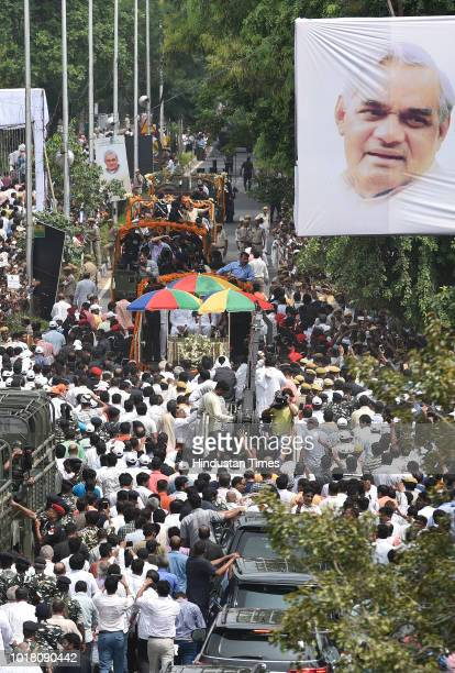 Followers of former Prime Minister Atal Bihari Vajpayee take part in his funeral procession along at DDU Marg on August 17 2018 in New Delhi India...