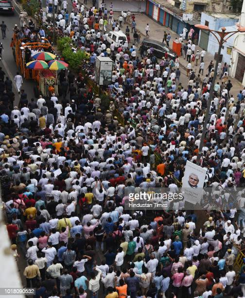 Followers of former Prime Minister Atal Bihari Vajpayee take part in the funeral procession at Daryaganj on August 17 2018 in New Delhi India...