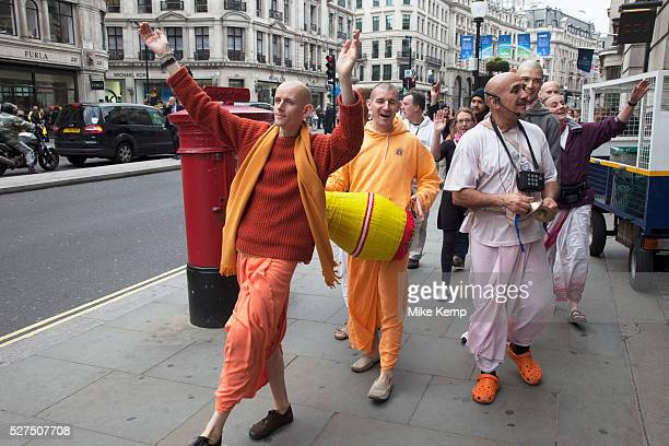Followers of Hare Krishna promoting their faith on Regent Street in London UK The Hare Krishna mantra also referred to reverentially as the Maha...