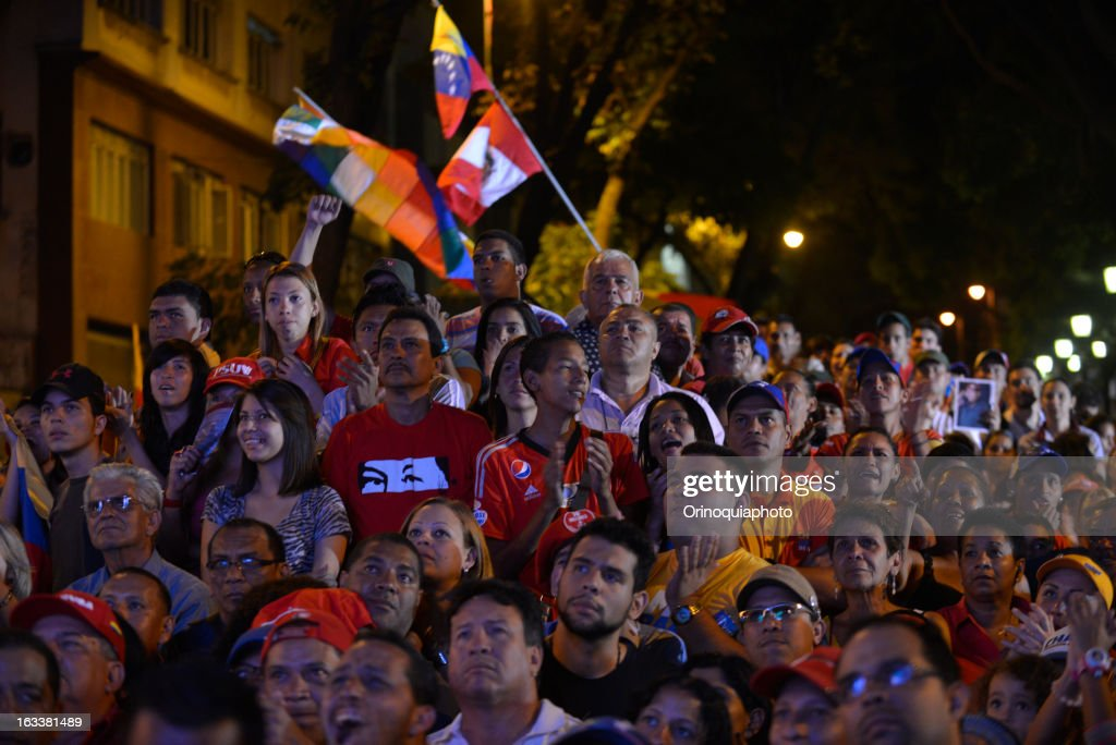 Followers of Nicolas Maduro observe outside of National Assembly his swearing as interim president of Venezuela for a period of 30 days after which Venezuelan will be called to elect a new president.