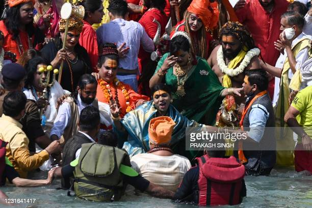 Followers of the Kinnar Akhara monastic Hindu order made up of transgender members take a holy dip in the waters of the River Ganges on the Shahi...