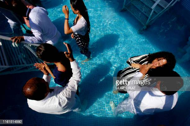 Followers of the Mexicanbased Pentecostal church Light of the World participate in a baptism ceremony in Guadalajara Jalisco state Mexico on August...