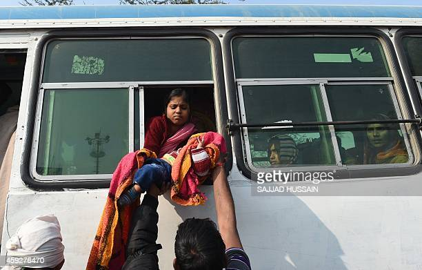 Followers of the selfstyled 'godman' Rampal Maharaj wait in a bus after leaving the ashram at Barwala in the district of Hisar some 175 kilometres...
