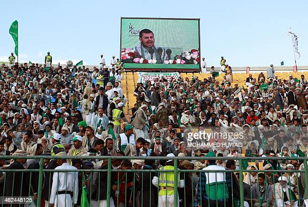 Followers of the Shiite Houthi group watch Shiite leader AbdulMalik alHouthi speaking on a giant screen during a rally marking the birth anniversary...