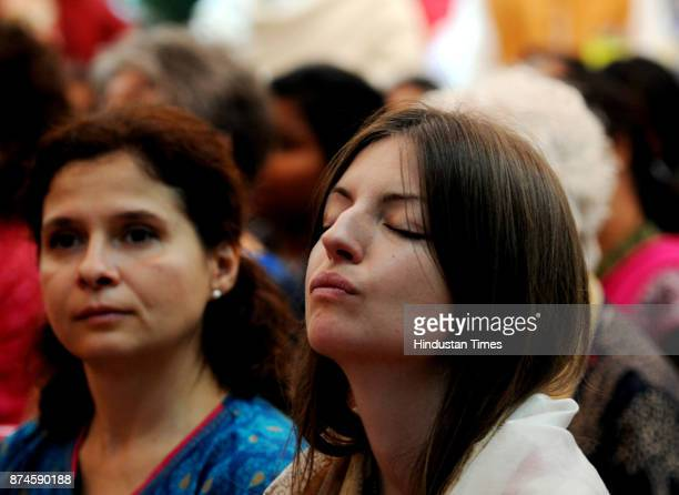 Followers of Yogoda Satsanga Society attend the releasing function of the holy book Bhagwad Geeta Hindi version God talks with Arjuna by President of...