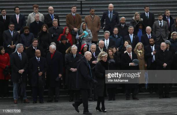 Following a brief stop of the hearse carrying the casket of the late Rep. John Dingell , Rep. Debbie Dingell , widow of Rep. John Dingell, returns to...