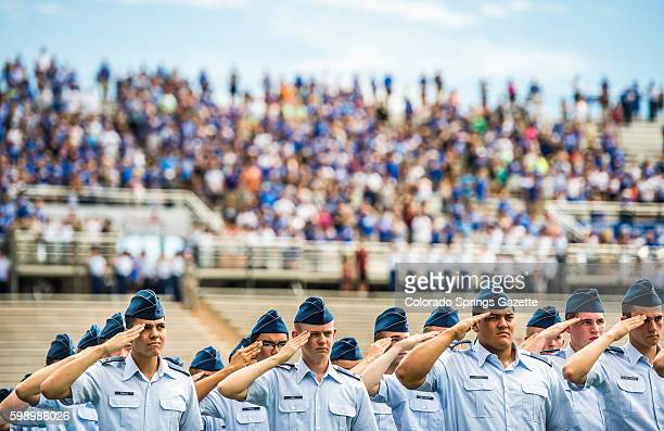 Following a moment of silence for former quarterback Dee Dowis who died August 29 in a car accident cadets salute during the playing of the national...