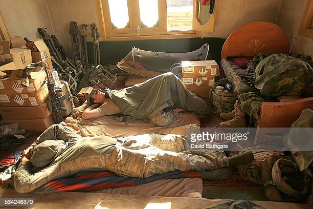 Following a night of patrol missions soldiers of Charlie Company the US Army's 10th Mountain Division catch up on sleep at Firebase Lindstrom Barge...