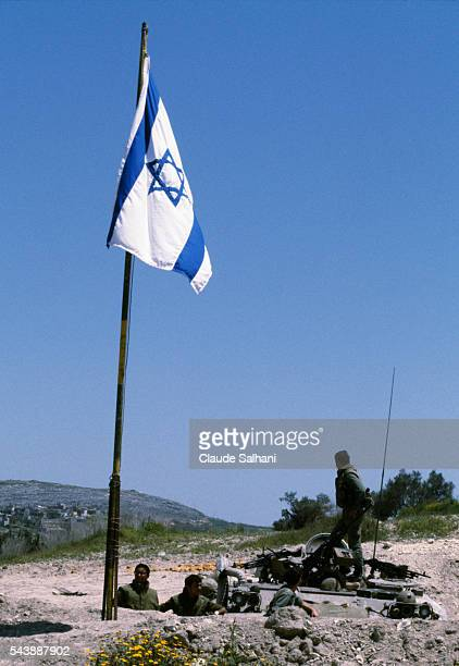 Following a short ceremony Israeli soldiers take down their flag and are replaced by soldiers of the United Nations Interim Force in Lebanon