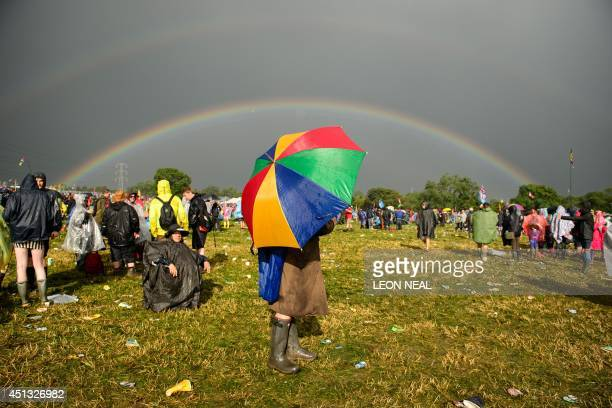 Following a very heavy rainstorm a double rainbow appears in the sky above the site on the first official day of the Glastonbury Festival of Music...