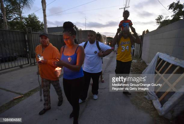 Following a vigil Patricia Todd second from left leads a group of family and friends out of the alley where her sister Alicia Todd was killed last...