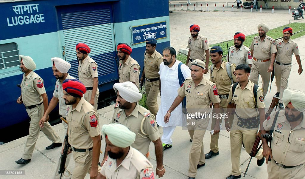 Following an August 28 court hearing Mumbai police escort alleged drug lord Jagdish Bhola one of the accused in a drug and money laundering case onto.