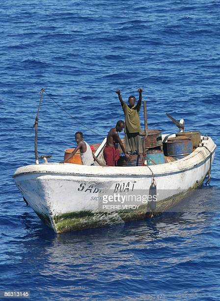 following army request this photo has been altered to conceal the identity of persons involved Three alleged pirates who have been taken back to...