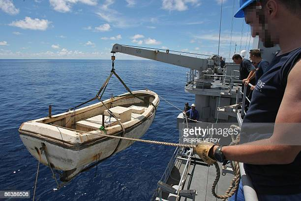 Following army request this photo has been altered to conceal the identity of persons involved The 'mother ship' of pirates is heaved on the french...