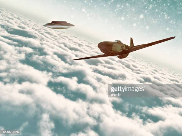 UFO following fighter airplane above the clouds