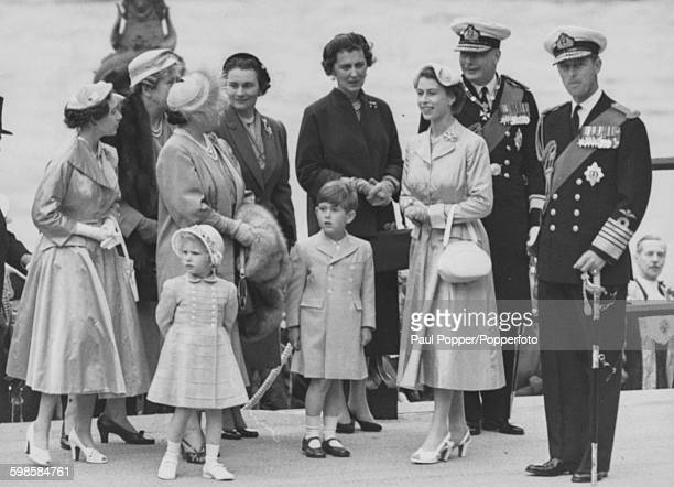 Following her return from a six month tour of the Commonwealth, Queen Elizabeth II arrives at Westminster Pier with Princess Margaret, Princess Anne...