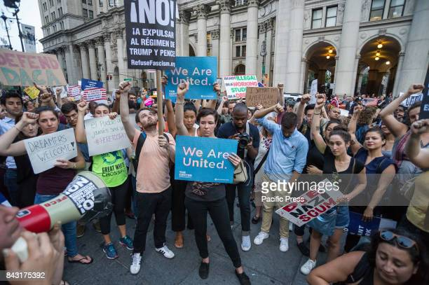 Following President Donald J Trump's decision to revoke the Obamaera DACA policy thousands of activists rallied in Manhattan's Foley Square and...