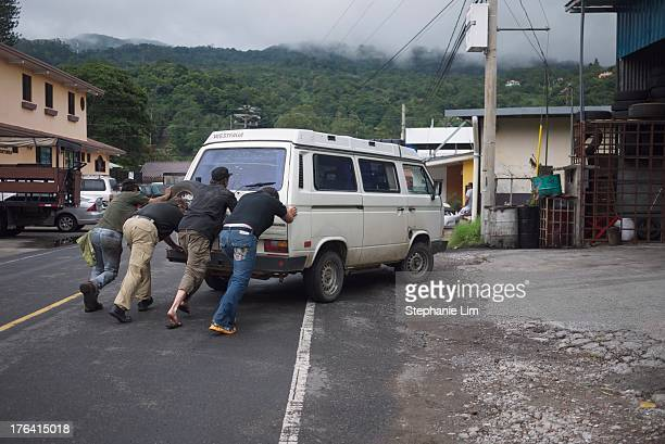 Following some gas problems, mechanics push a Volkswagen Vanagon Westfalia into a workshop in Boquete, Panama.