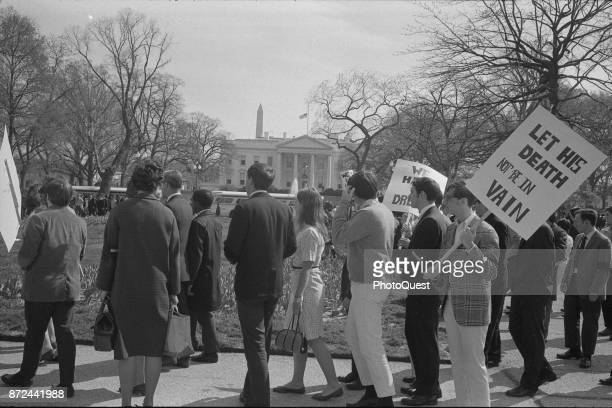 Following the assassination of Dr Martin Luther King Jr demonstrators several with signs picket in front of the White House Washington DC April 1968...