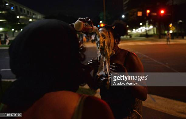 Following the death of George Floyd in Minneapolis protest in downtown Charlotte turn violent as someones eyes are cleaned with milk from teargas in...