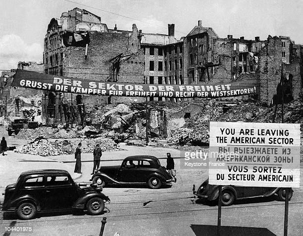 Following the end of the Berlin blockade, a banner in the Communist sector proclaims: The sector of liberty greets all those who fight for law and...
