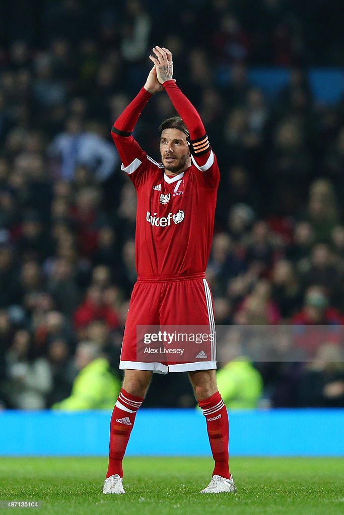 Following the final whistle David Beckham of Great Britain and Ireland applauds the fans during the David Beckham Match for Children in aid of UNICEF between Great Britain & Ireland and Rest of the World at Old Trafford on November 14, 2015 in Manchester, England.